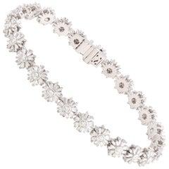 Studio Rêves Floral Tapered Baguette Diamond Tennis Bracelet in 18 Karat Gold