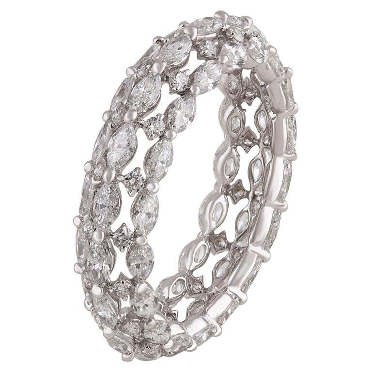 Marquise and round white diamonds and 18-karat white gold band