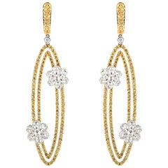 Studio Rêves Oval Dangling Diamonds Earrings with Yellow Sapphire in 18k Gold