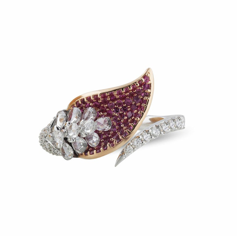 Diamond and pink sapphire ring  The design of this cocktail ring is a lesson in superior artistry. Handcrafted with pear rosecut and round brilliant cut diamonds alongside luminescent pink sapphires, it boasts a delicate yet impactful balance that