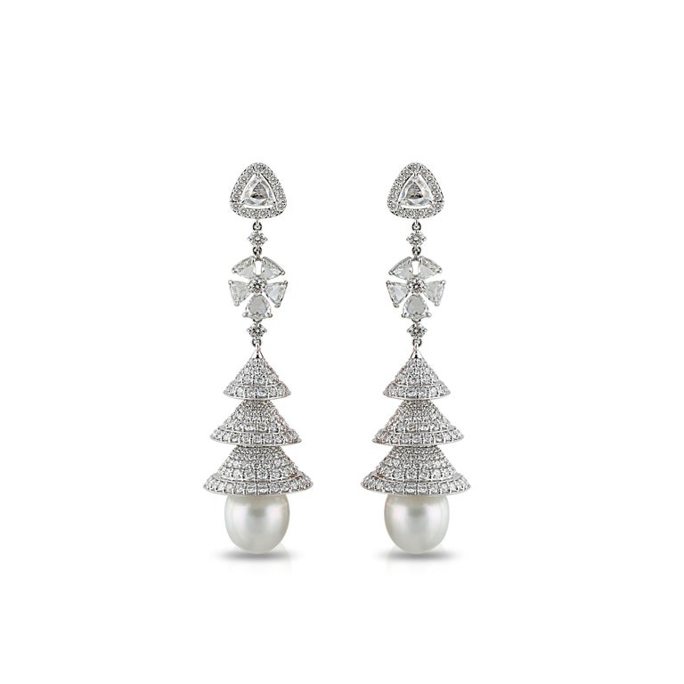 Diamonds and South Sea Pearl Earrings  The artistic setting of these diamond and pearl earrings is fit for modern day royalty. The dancing domes feature trillion rosecut and round brilliant cut diamonds in prong and pave settings, rounded off with