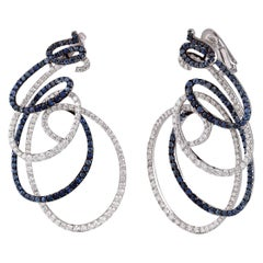Studio Rêves Spiral Blue Sapphire and Diamond Dangling Earrings in 18 Karat Gold