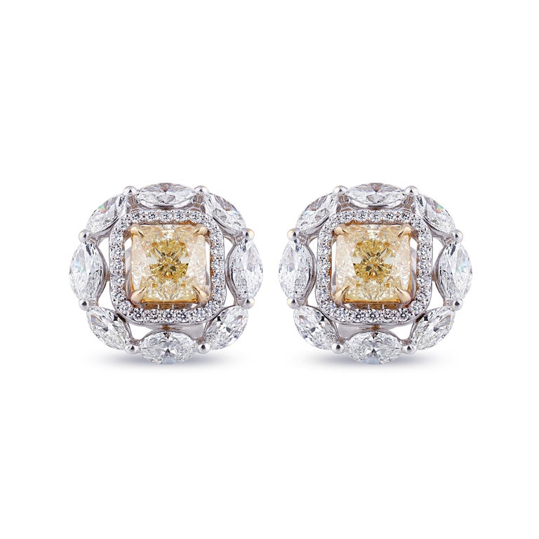 Classic stud earrings are worth the investment when they enamors you. This 18K white and yellow gold earrings studded with round, marquise brilliant cut and yellow cushion cut diamonds in a prong setting does just that. Featuring 68 stones its
