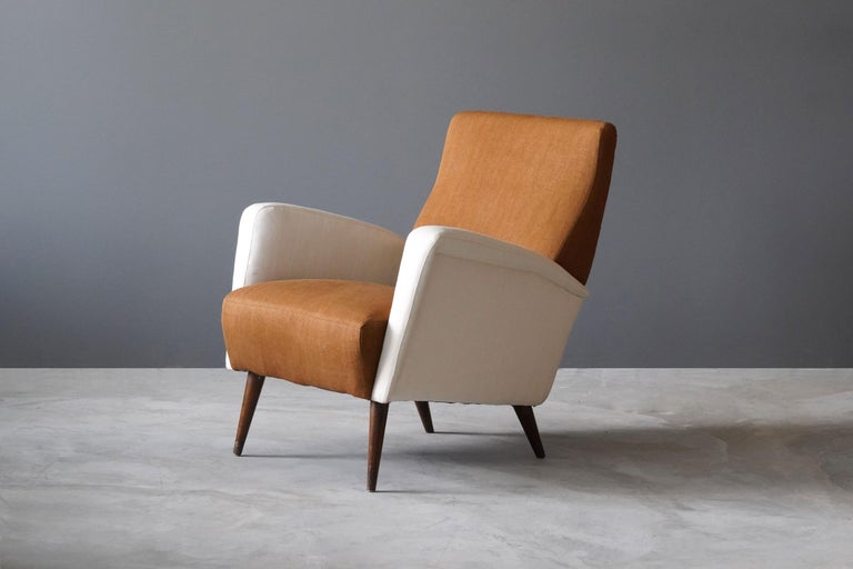 A lounge chair / armchair designed by Studio Tecnico Cassina. Produced by Figli di Amedeo Cassina, Meda, Italy, 1950s.   Newly reupholstered in brand new high end fabrics. Designed by Studio Tecnico headed by Gio Ponti.