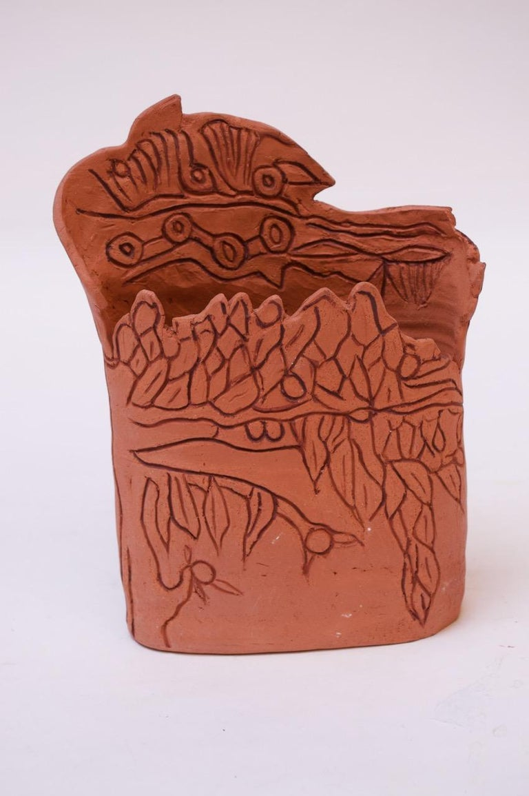 Terracotta vase with hand-drawn details depicting a tree with fruit, circa 1970s, USA.  Signed