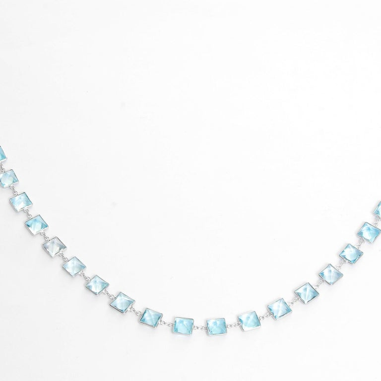 Stunning 14K White Gold Blue Topaz by the Yard Necklace - .  14K White Gold with Square Blue Topaz stones. Length 20 inches. Total weight 16.9 grams. Perfect to wear with an every day outfit or a night outfit.