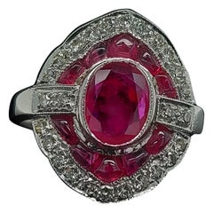 Stunning 18 Karat White Gold Ring with Rubies and Brilliant Cut Diamonds