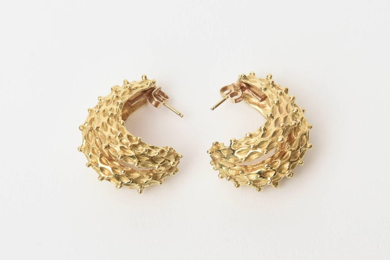 These gorgeous and stunning pair of classic vintage Italian 18K Gold pierced loop earrings are very textural and dimensional. They have great weight to them in the best of ways. Their weight is 25.7 grams or 16.2 DWT. They are marked 18K with 2
