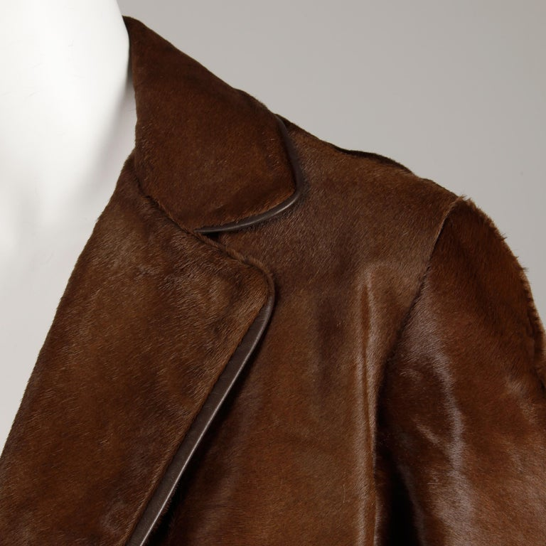 Stunning vintage brown fur coat from the 1960s in incredible condition (rare to find one of these without balding). Drop waist and pleated detail in the bottom back. Fully lined with front double button closure. Hidden side pockets. Fits like a