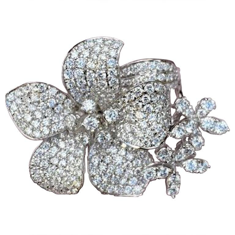 Stunning 6 Carat Pavé Diamond Triple Flower Ring in 18 Karat White Gold For Sale