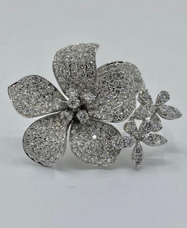 Magnificently styled, 18 karat white gold cocktail ring in the shape of a 3 dimensional cluster of blooming flowers features 259 round brilliant, pave and prong set white diamonds.  259 white diamonds in the mounting weigh approximately 6 carats.