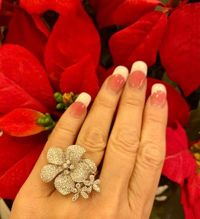 Contemporary Stunning 6 Carat Pavé Diamond Triple Flower Ring in 18 Karat White Gold For Sale