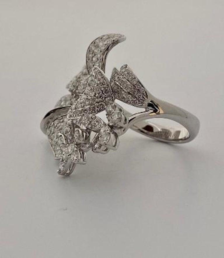 Women's Stunning 6 Carat Pavé Diamond Triple Flower Ring in 18 Karat White Gold For Sale