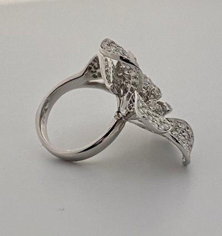 Stunning 6 Carat Pavé Diamond Triple Flower Ring in 18 Karat White Gold For Sale 2