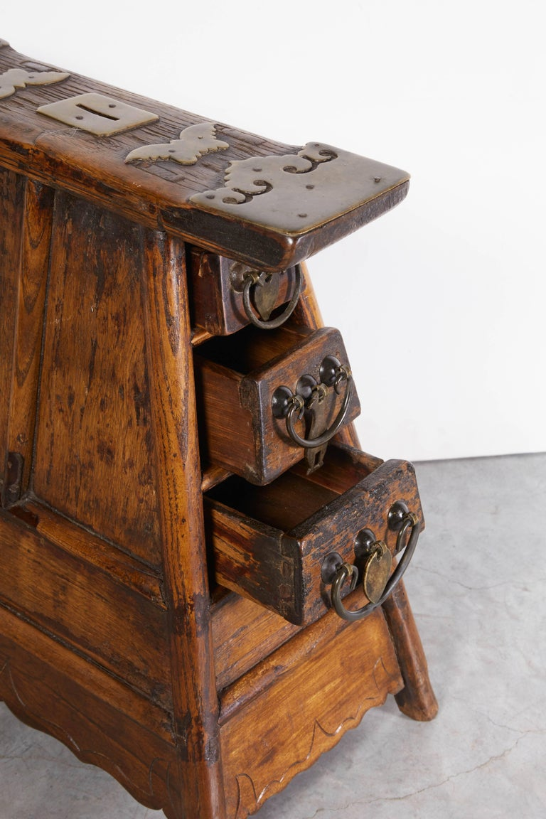 A Classic antique Chinese barber stool, rarely found in this excellent condition with original fittings and outstanding design. A handsome object certain to provoke conversation. China, Gansu Province. M519.
