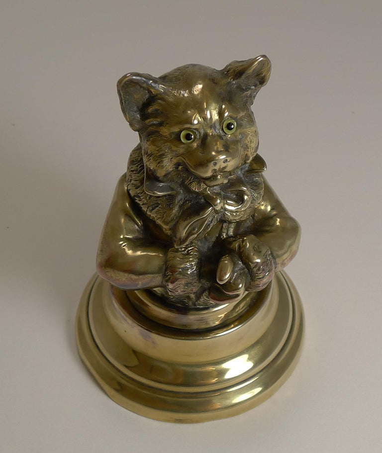 A stunning figural inkwell, made from English brass, the top portion possibly cast in copper and finished in brass, with copper highlights showing through.