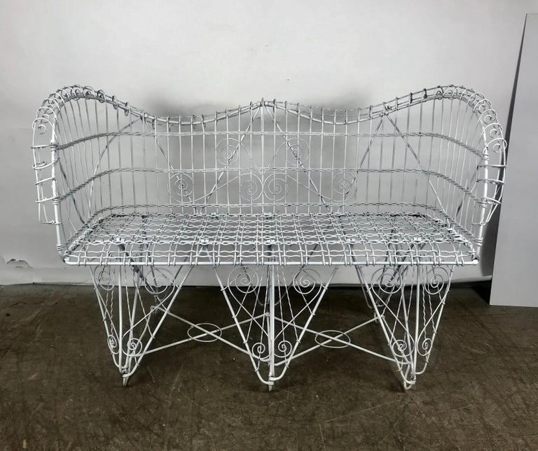 Stunning antique wire iron garden bench manner of Salterini, excellent condition, perfect addition to your outdoor living environment.