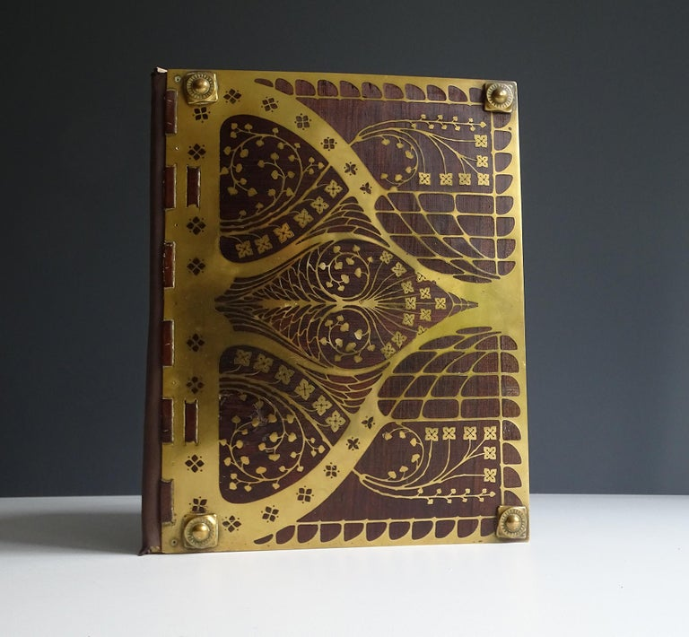 Exceptional Art Deco desktop document holder manufactured, circa 1920. The speciality of the factory was the combination of rosewood and stencilled brass motive, this absolutely unique example of their work is one of the most intricate they