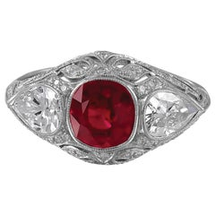 Stunning Art Deco Style Platinum Ring with Ruby Center Two Pear Shapes Diamonds