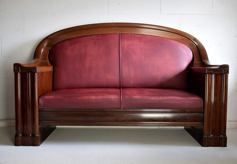 Sophisticated 1930 Danish Art Deco sofa produced by C.B. Hansens furniture makers appointed by the Danish Royal Court. This beauty has leather upholstery and a frame made of mahogany, stained Mahogany and darkened Italian Walnut. The sofa is in