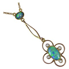 Stunning Art Nouveau 15 Carat Gold Black Opal and Seed Pearl Pendant