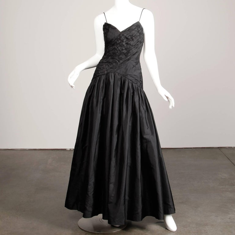 Absolutely stunning vintage black silk evening dress from the 1990s by Bergdorf Goodman. Fully lined with rear zip and hook closure and removable/adjustable shoulder straps. The marked size is 8, but the dress fits like a modern small. 100% Thai