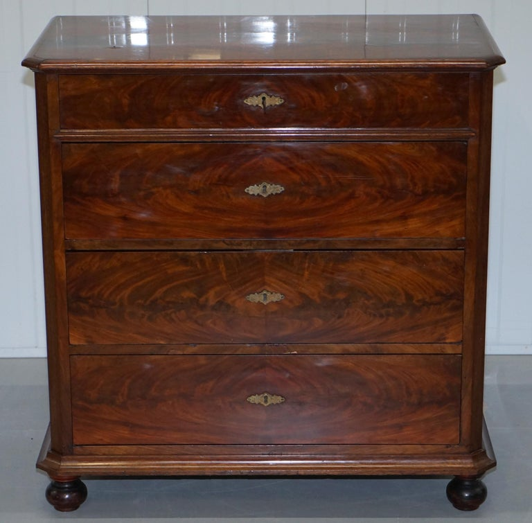 We are delighted to offer for sale this lovely circa 1820 flamed mahogany Biedermeier chest of drawers  A good looking and well-made chest with a rich warm patina to the timber, the one key which is original operates all locks, these types of