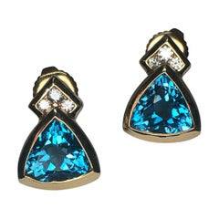 Stunning Blue Topaz and Diamond Earrings in 14 Karat Yellow Gold