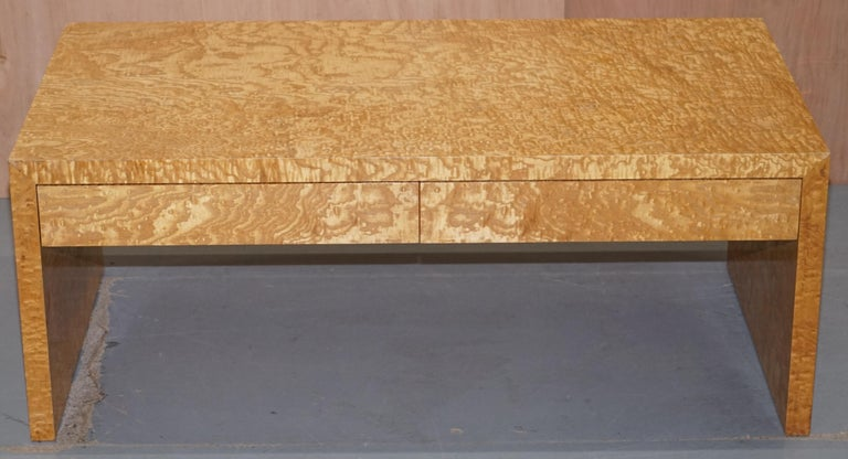 We are delighted to offer for sale lovely Burr Satinwood two drawer coffee table which is part of a suite  The timber patina on this piece is simply glorious, it any light it looks good enough to eat but in the right light it looks sublime. The