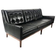 Stunning Button Tufted Leather and Walnut sofa by Gunlocke, Jens Risom Design