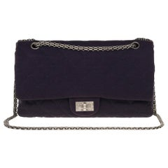Stunning Chanel 2.55 handbag in quilted navy blue jersey and silver hardware