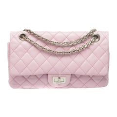 Stunning Chanel 2.55 shoulder bag in pink quilted leather with silver hardware