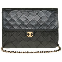 Stunning Chanel Classic handbag in black quilted lambskin with gold hardware