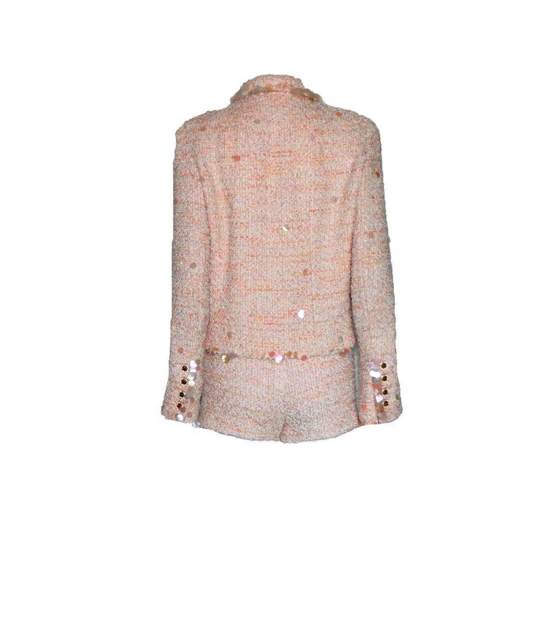 Amazing Chanel suit In the signature fantasy tweed fabric exclusively produced by Maison Lesage Designed by Karl Lagerfeld for his iconic 1995 Chanel collection Collectable item Shiny big sequins CC logo buttons on sleeves Amazing pastel