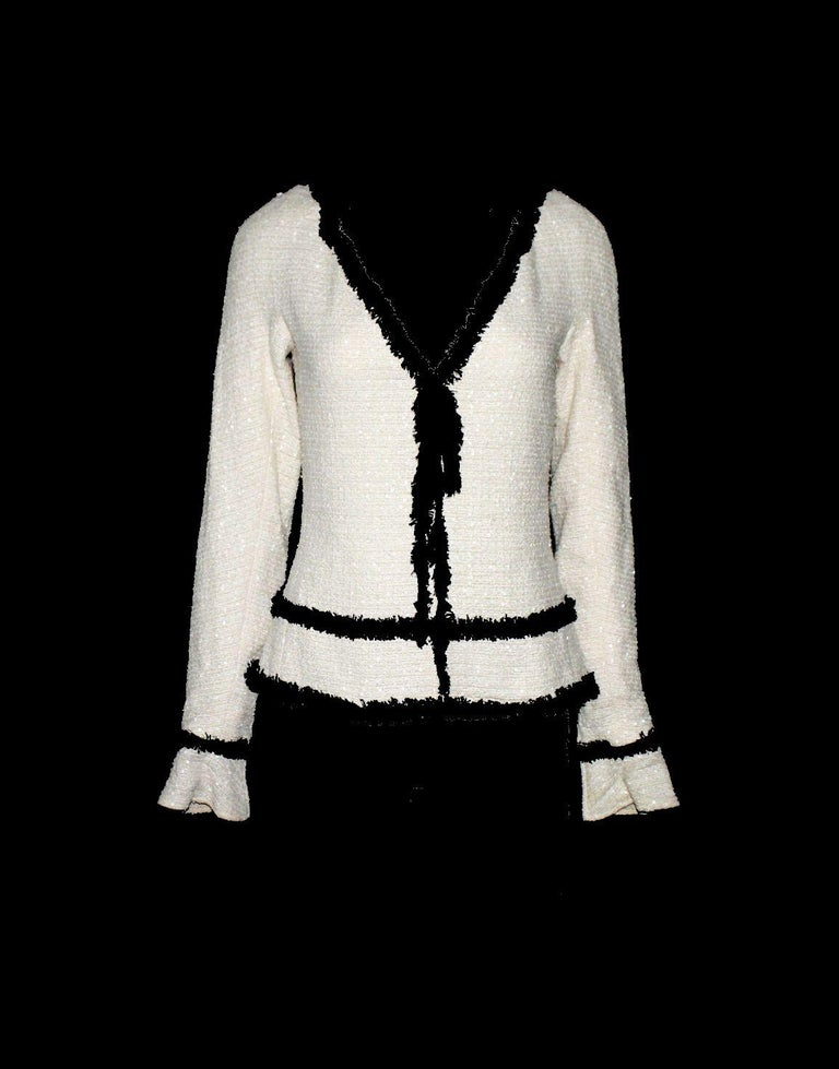 Chanel signature jacket Designed by Karl Lagerfeld Classic Chanel monochrome signature style that never goes out of style Stunning ivory tweed produced by Maison Lesage exclusively for Chanel Black fringed tweed trimming Bow-tie detail in