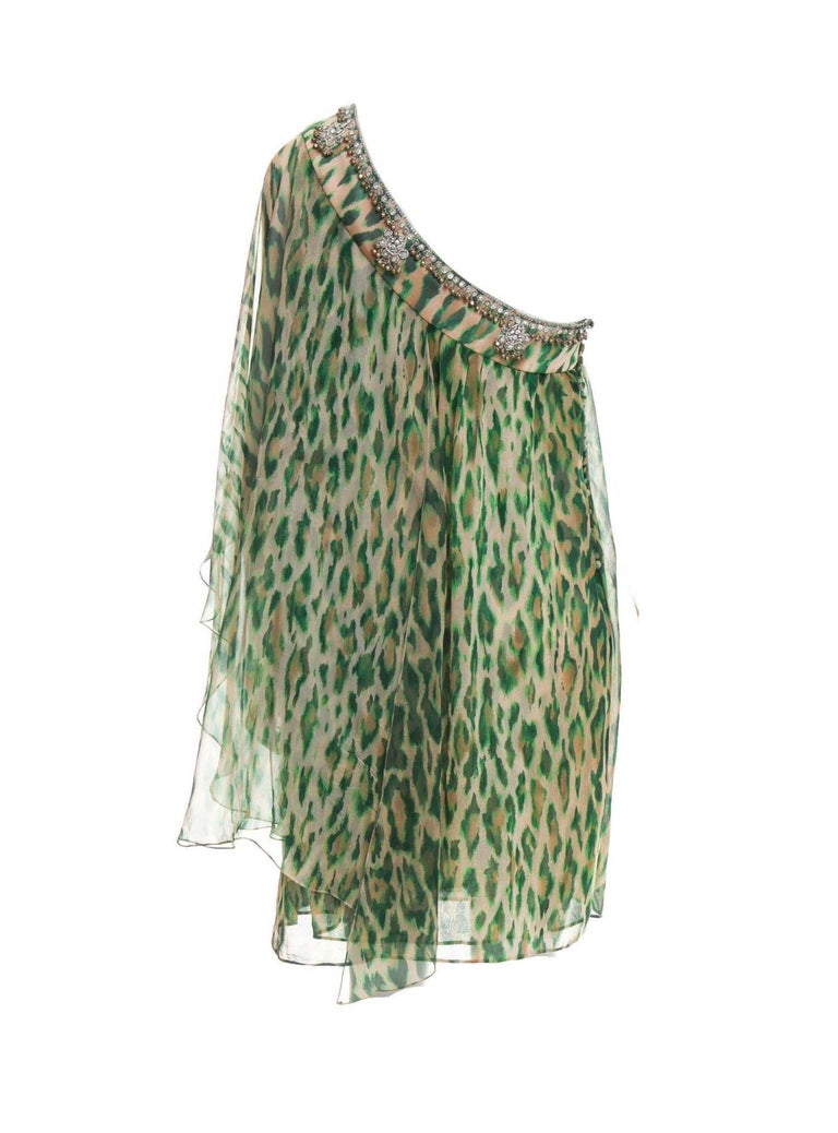 Amazing dress by Christian Dior Finest chiffon silk Cheetah print One shoulder Hand-embellished Simply slips on Closes on side with Dior signature buttons Dry Clean Only Made in France FR40 Retails for 8799$ plus taxes