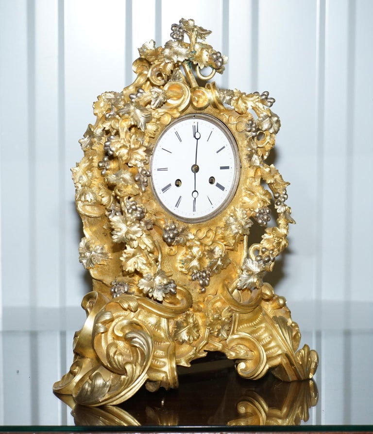 We are delighted to offer for sale this lovely handmade in France circa 1860 very decorative gold gilt bronze mantel (fireplace) clock
