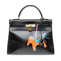 "Stunning Creation Kelly 32 ""Rodeo"" handbag in black calfskin , gold hardware"