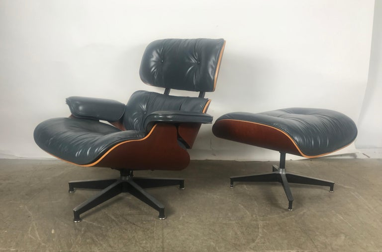 Stunning 670 and 671 lounge chair and ottoman by Charles and Ray Eames manufactured by Herman Miller, custom ordered slate blue leather, amazing color, cherry plywood shell, nice original condition, minor wear to buttons and back of one arm,