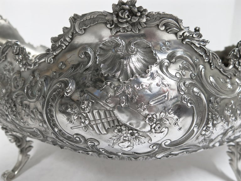 A large oval footed, beautifully hand chased centerpiece bowl made by the French Parisian silversmith Emile Delaire, circa 1890s. The centerpiece measures 21.50