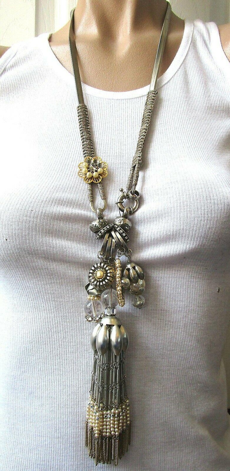 Fabulous Miriam Haskell Designer Necklace featuring Charms with Crystal, Pearl and Chain Tassels. Oversized spring ring clasp at the front or just slips over the head. Necklace measures approx. 28