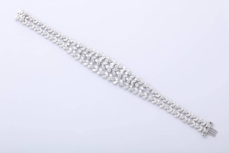 A fabulous diamond bracelet -- a beautiful design with a large look.   14.48 carats of white round brilliant and marquise cut diamonds set in 18k white gold   A beautiful design and full of sparkle -- pictures do not do this piece