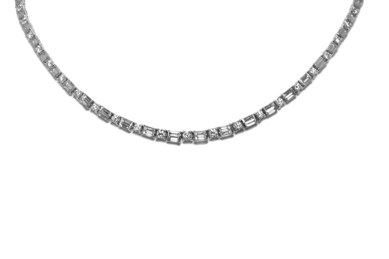 The necklace is finely crafted in platinum with diamonds weighing approximately total of 11.00 carat.