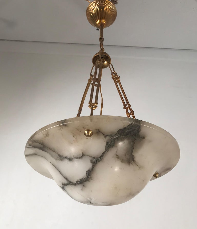Small in size and highly stylish chandelier with rare brass chain.  If you are looking for a fine quality, handcrafted and hand carved alabaster pendant from the Arts & Crafts era then this Fine specimen could be ideal for you. The black veins in