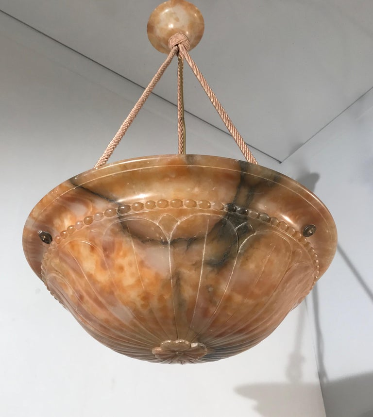 Great shape and marvelous museum condition, Classical design Art Deco lighting with impressive decor of curved leafs, hung by silk cord. ps.changing to chain is also possible to your needs.  This sizeable alabaster pendant with matching alabaster
