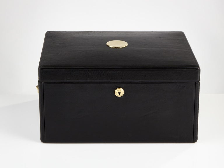 A stunning early 20th century black leather document box, circa 1910. This box could serve as jewel box or for a watch collection having multiple lift out trays as shown, lined in suede and velvet. The lid hinges completely back which acts as a