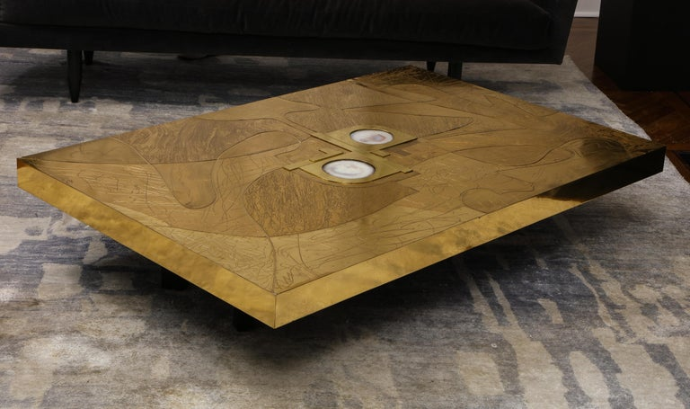 Stunningetched brass and double agate cocktail table. This is a one of a kind, off the floor model that is available for immediate purchase for a discounted price. The table is in good condition with minor scratches and blemishes that are