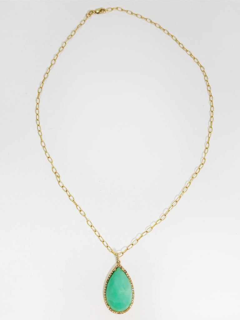 A stunning faceted chrysoprase and diamond pave pendant necklace in 14 kt. yellow gold. Lovely modernist faceting and setting. Necklace is very fine and lightly textured  Chrysoprase is a gemstone variety of chalcedony, beloved by crystal lovers but