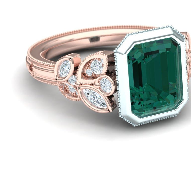 A simple and stunning ring with a rose and white gold combo holds both white brilliant diamonds and a deep pure blue green tourmaline.  The center stone on this ring is held in 18k white gold and is bezel set.  The center stone is 2.2 carats.  The