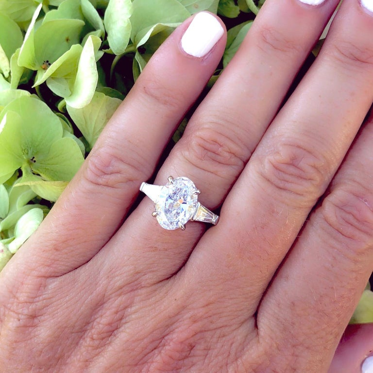 The new must have diamond! This gorgeous 3.45 carat GIA graded E color VS2 clarity has everything the oval cut lover wants: vibrant sparkle and fire, brilliant play of light, wonderful color and clarity, and size to spare! The well cut stone is
